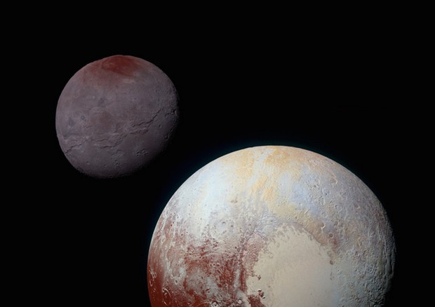 Plutone e Caronte insieme, viste dalla sonda New Horizons nel luglio 2015. (fonte: NASA / Johns Hopkins University Applied Physics Laboratory / Southwest Research Institute) © Ansa